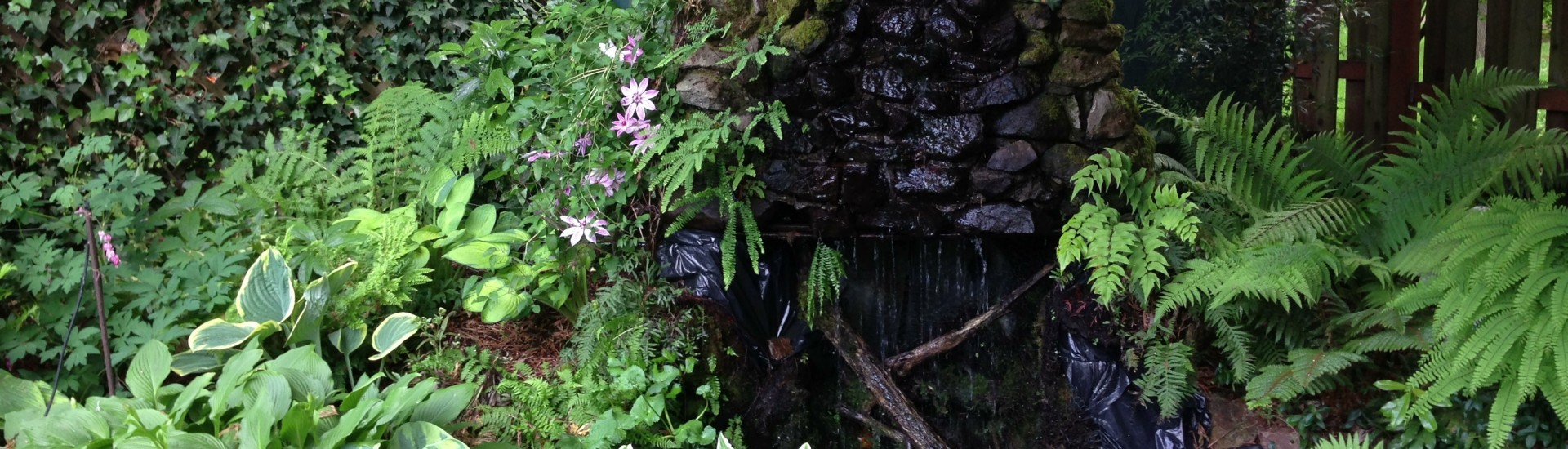 Unusable fireplace chimney becomes a pond waterfall.